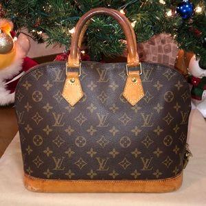 Louis Vuitton Alma Monogram Handbag